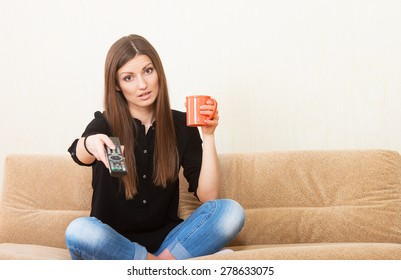 Relaxed girl watching TV