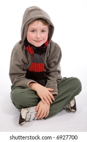 A relaxed and happy young boy sitting down