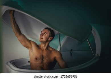 Relaxed man is floating in a sensory deprivation tank. He is very relaxed. Wellness and Spa concept.