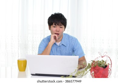 Relaxed man with laptop in the home.