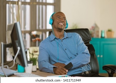 Relaxed man listening to music or other media