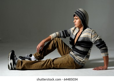 relaxed man sitting on the floor ,isolated