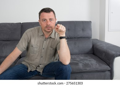 Relaxed  man sitting on sofa in the house