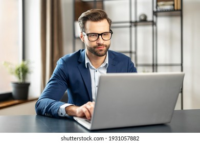 Relaxed man working at contemporary office, typing on keyboard, sitting on comfy chair, feels serenity, enjoy fresh conditioned air, no stress, fatigue relieve at workplace concept, great atmosphere