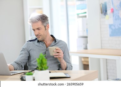 Relaxed man working form home on laptop