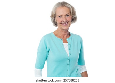 Relaxed mature woman casually posing to camera