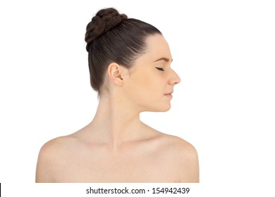 Relaxed natural model posing on white background