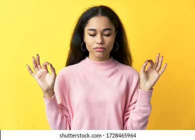 Relaxed pretty woman keeps hands in mudra gesture with eyes closed. meditation, patience concept