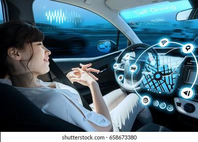 relaxed woman in autonomous car. self driving vehicle. autopilot. automotive technology.