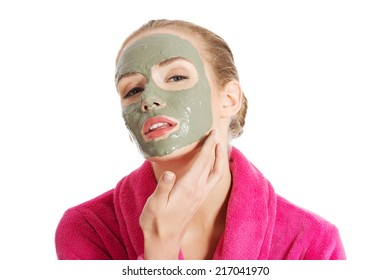 Relaxed woman with  a deep cleansing nourishing face mask applied to her face, beauty and skincare concept - Shutterstock ID 217041970