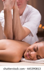 Relaxed woman lying during professional back massage