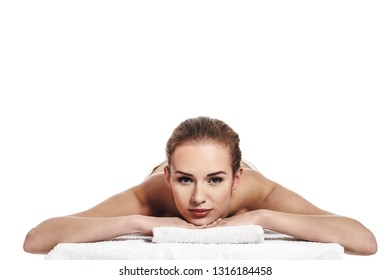 Relaxed woman lying for massage, isolated. Spa concept. Copy space.