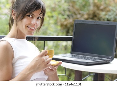 relaxed woman in outdoor scene with laptop
