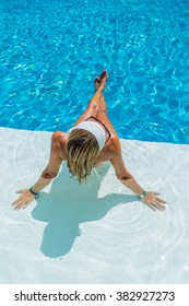 A  relaxed woman in the pool