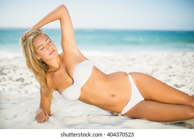 Relaxed woman posing at the beach on a sunny day