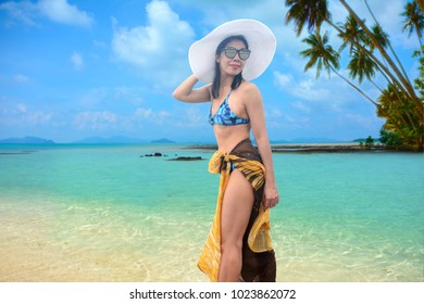 Relaxed woman walking on the tropical beach