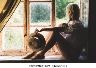 Relaxed woman at window