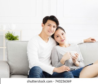 relaxed young asian Couple on sofa