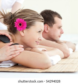 Relaxed young couple enjoying a Spa treatment in a Spa center