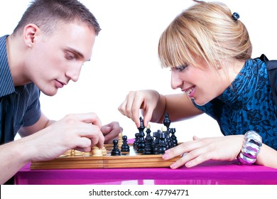 Relaxed young couple playing chess at home, isolated on white