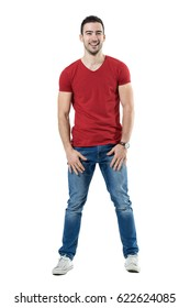 Relaxed young laughing casual man looking at camera. Full body length portrait isolated over white studio background.