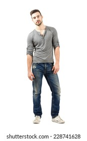 Relaxed young male model posing.  Full body length isolated over white background.
