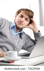 Relaxed young man in office