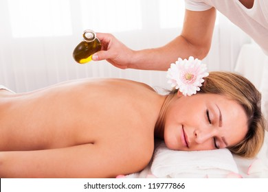 Relaxed young woman getting a spa treatment