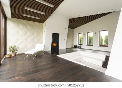 Relaxing area with lounge chair and white 3d wall