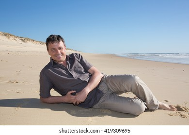 Relaxing and attractive man on a beach