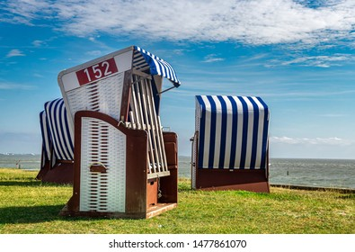 Relaxing in Beach chair on island Norderney, travel island germany