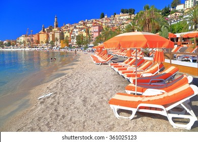 Relaxing beach chairs on sandy sea shore near Menton, French Riviera, France