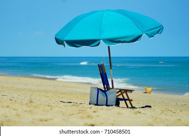 Relaxing Beach Scene in the Beautiful Beaches of North Carolina with Umbrella and Beach Chair.