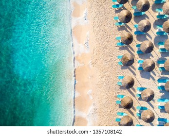 Relaxing beach top down view with chairs and umbrellas