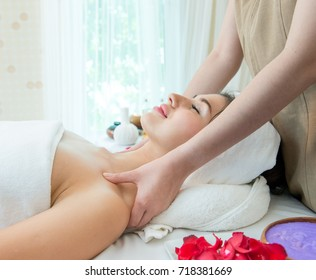 Relaxing beautiful woman having a massage for her skin on a face in beauty salon – horizontal, Beautiful young woman receiving facial massage with closed eyes at spa studio, Age 20-30 years,