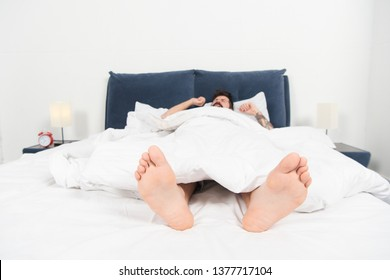 Relaxing in bedroom. Sweet dreams. asleep and awake. male in bed. man sleep in morning. energy and tiredness. sleepy man in bedroom. day dreaming male. Day sleeping. Good nap. Time to rest.
