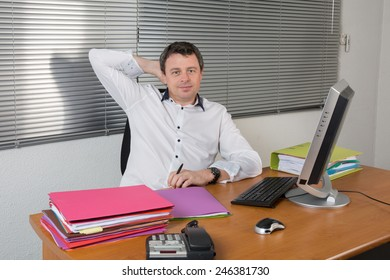 Relaxing business man behinh his desk