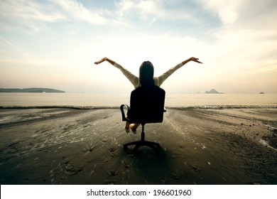 Relaxing business woman sitting on beach, Success in business concept