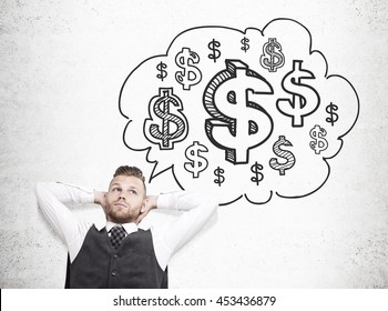 Relaxing businessman daydreaming about money on concrete background with dollar sign sketch inside thought cloud. Financial growth concept