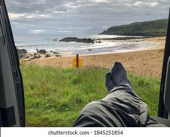 Relaxing in a camper van on a beach in Ireland