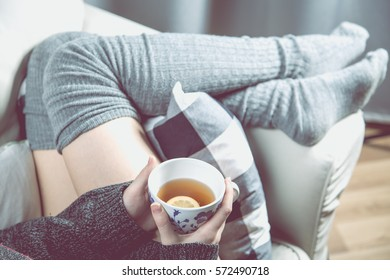 Relaxing concept with hot tea and sofa