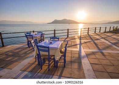 Relaxing dinner tables on the seaside of Edipsos, Island of Evia, Greece