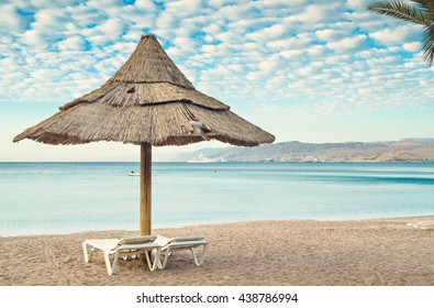 Relaxing facilities on central beach of Eilat - famous resort and recreation city in Israel. Image slightly toned for inspiration of vintage style