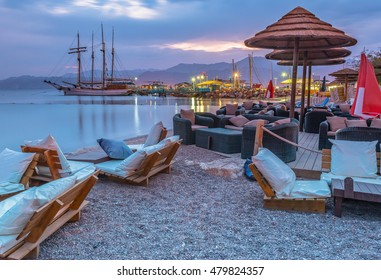 Relaxing facilities and pleasure vessels at the central beach of Eilat - famous resort and recreation city in Israel