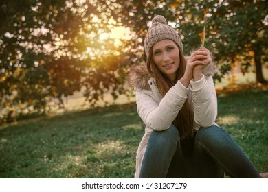 relaxing female in autumn park