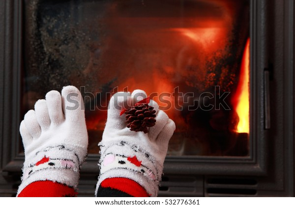 Relaxing Fireplace Colorful Funny Toesocks Stock Photo (Edit