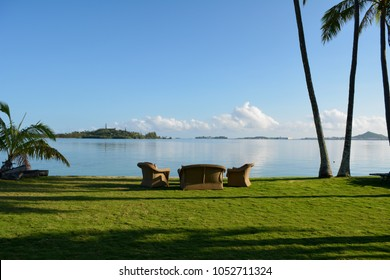 Relaxing grassy area next to a calm Kaneohe Bay on Oahu.