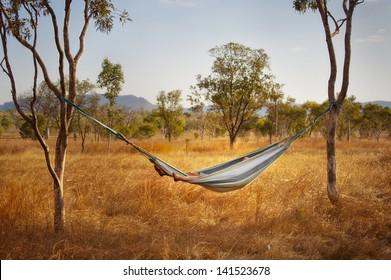 Relaxing in a hammock in the Australian outback.