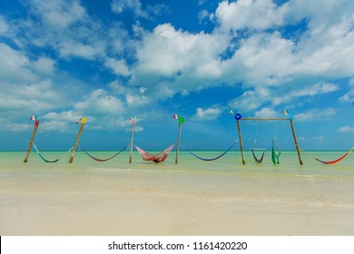 Relaxing in a hammock over the water, Isla Holbox, Mexico