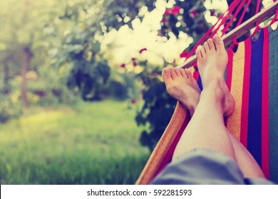 relaxing in the hammock in the summer garden